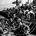 Men and supplies are ferried out to landing crafts en route to the initial Allied invasion of Normandy. (AP Photo/Peter Carroll)