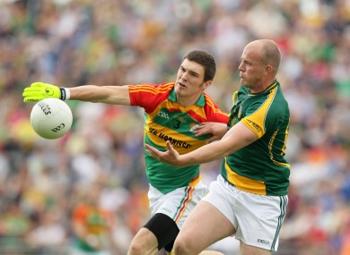 Carlow's Conor Lawlor and Joe Sheridan of Meath contest a loose ball.