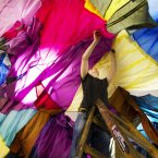 Technician Stephen Dodd hangs up artist Angela Fulcher piece entitled