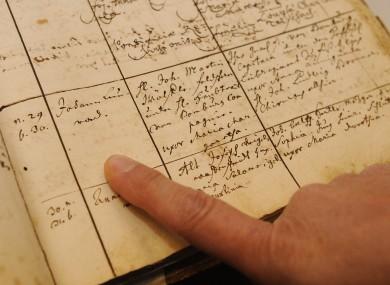 A person reads an entry in a parish register r in Besigheim, near Stuttgart, southern Germany