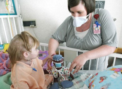 Cystic fibrosis patient Malea Gardner with Child Life Specialist Catherine Coakley