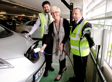 Valerie Singleton, DAA Landside Facilities Manager, tops up the first electric car at the new charging points with DAA car park co-ordinators Padraig Lavin and Pat O'Keeffe.