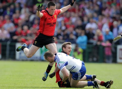 Garvey (left) in action during the Ulster SFC semi-final against Monaghan.