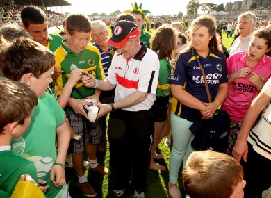 Solidarity: Tyrone manager Mickey Harte signs autographs after Saturday's defeat in Killarney.
