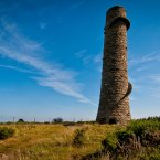 This one isn't too far from Shankill village in south Dublin to where mined lead ore was brought from the small lead vein at Ballycorus. The smelter closed in 1913 but this chimney, built on a hill an dused to conduct away the noxious fumes, still stands. Image: Joe King/Flickr.