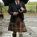 'So that's where my hat went. Now I'm stuck using this umbrella which does nothing for my outfit.' (Danny Lawson/PA Wire)