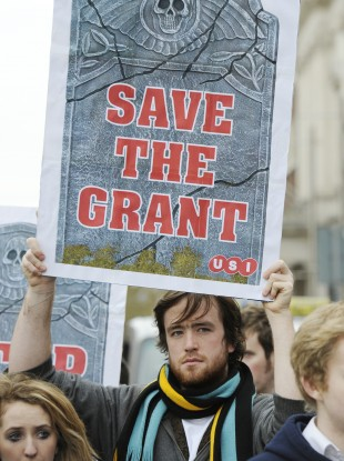 A student participates in a demonstration last year against cuts to college grants. South Tipperary County Council has abandoned plans to link grant payments to the €100 household charge.