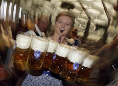 A waitress carries beer mugs in the Hofbraeuhaus tent.