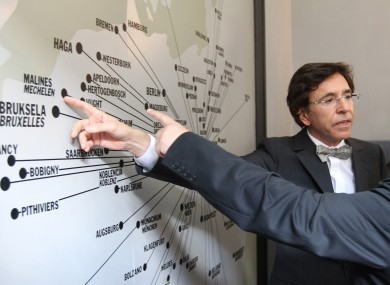 Belgium's Prime Minister Elio Di Rupo points at a map from where in Europe Jews were transported, at the former Nazi death camp of Auschwitz in Oswiecim, southern Poland