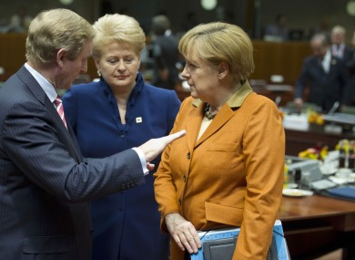 Enda Kenny speaks with Angela Merkel and Lithuanian President Dalia Grybauskaite at an EU summit in Brussels on 18 October