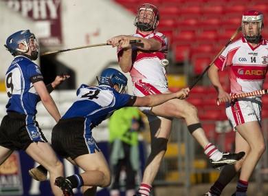 Sarsfields Daniel Roche and Conor O'Sullivan and De La Salle's John Mullane in action two years ago.