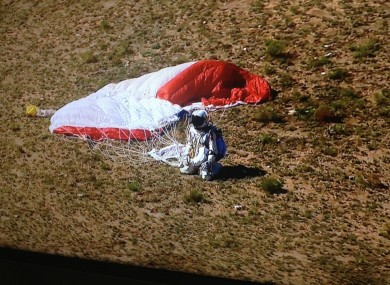 Felix Baumgartner touches down in New Mexico after jumping from 24.2 miles above ground - a new world record.