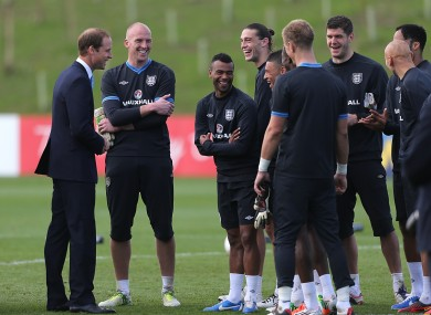 Britain's Duke of Cambridge meets England players after training.