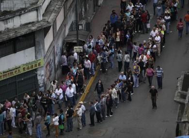 People line up to vote in Caracas in Venezuela today