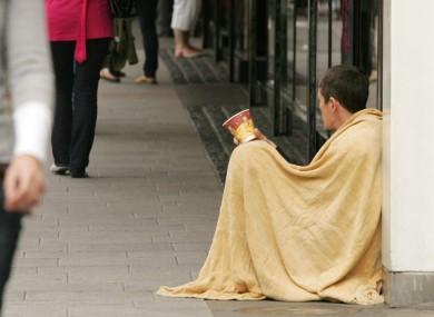 A person begs in Dublin City centre.