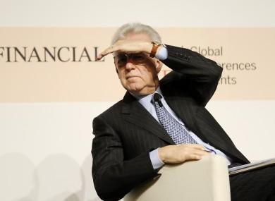 Italian premier Mario Monti at a meeting in Milan today