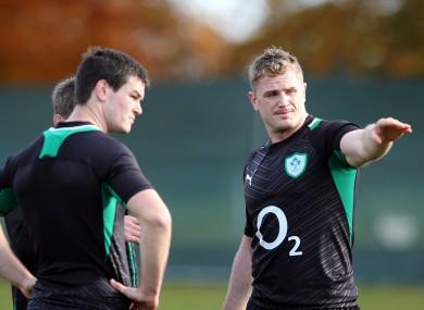 JJamie Heaslip (right) gives directions to Jonny Sexton.