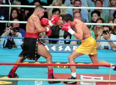 Hector Camacho, left, fights Oscar De La Hoya in Las Vegas in 1997.