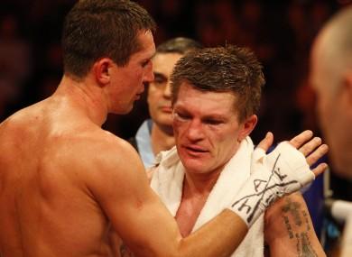 Ricky Hatton (centre) is consoled by winner Vyacheslav Senchenko.