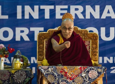 Tibetan spiritual leader the Dalai Lama speaks at a meeting in India
