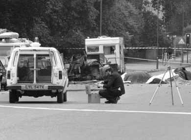 A police photographer at the scene, following the IRA's bombing of Hyde Park, London.