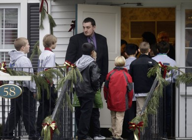 Mourners arrive for the funeral of school shooting victim, Jack Pinto aged 6.