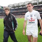 Glum faces. Kildare manager Kieran McGeeney and attacker John Doyle troop off the Croke Park pitch in disappointment after their season-ending defeat to Cork. (INPHO/Lorraine O'Sullivan).