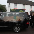 The funeral of Kerry GAA legend Páidí Ó Sé pauses at the family home in Ventry.