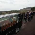Páidí Ó Sé's funeral cortege makes its way towards Reilig Caitliona.