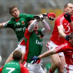 Spot the ball. Mayo's Pat Harte and Barry Moran, and the Cork duo of Alan O'Connor and Fintan Goold, all rise in an attempt to collect possession. For O'Connor and Goold there is the eventual consolation of victory as Cork win their third successive Division 1 league title. (INPHO/James Crombie).