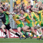 Champions. Paul Durcan, Neil Gallagher, Michael Murphy, Eamon McGee and Dermot Molloy celebrate after the final whistle sounds to confirm their All-Ireland win. (INPHO/Cathal Noonan).