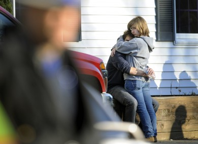 People embrace at a firehouse staging area for family around near the scene of a shooting at the Sandy Hook Elementary School in Newtown, Connecticut.