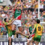 Rising high. Aidan O'Shea tries to inspire Mayo by fetching the ball above Donegal's Rory Kavanagh. (INPHO/Cathal Noonan).