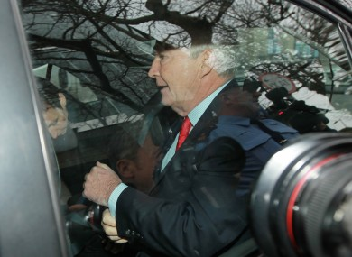 Seán FitzPatrick is driven away from Dublin District Court after being remanded on bail following charges of making misleading statements to Anglo's auditors.
