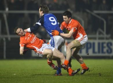 Armagh's Finnian Moriarty and Aidan Forker tackle Cavan's Gearoid McKiernan.