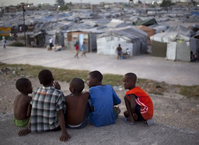 A group of boys look across Jean Marie Vincent camp in Port-au-Prince, Haiti, on Wednesday where they now live.