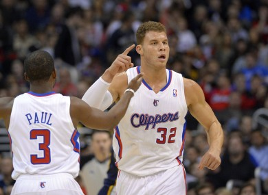 Blake Griffin and Chris Paul celebrate a Clippers score.