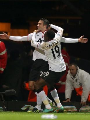 Van Persie celebrates scoring the equaliser against West Ham yesterday.