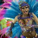 A performer from the Unidos de Vila Isabel samba school parades during Carnival celebrations (AP Photo/Felipe Dana).