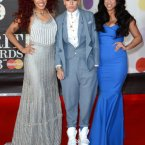 We love the middle one in Stooshe's style, including the nod to the greatest moment in Brits history via her footwear (Spice Girls, obvs.).  Doug Peters/Doug Peters/EMPICS Entertainment