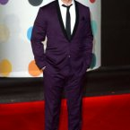 Robbie Williams knows how to wear a suit.  Even a purple one.  Doug Peters/EMPICS Entertainment