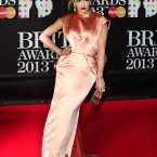 Rita Ora, this is an awful shame now.  That colour and sheen on a fabric was bad on bridesmaid's dresses in the 80s, and it's certainly not good now.  Also, how are you standing like that?!?  Ian West/PA Wire/Press Association Images