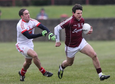 Louth's Sean O'Brien tackles Sean Armstrong of Galway.