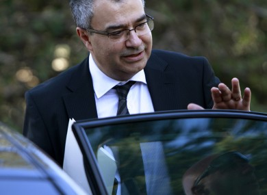 Cyprus Central Bank chief Panicos Demetriades leaves a meeting with the president in Nicosia earlier today