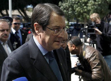 President Nicos Anastasiades arrives at the parliament before a meeting yesterday. Anastasiades and opposition leaders could travel to Brussels today to appeal for a deal to lend Cyprus €10 billion.