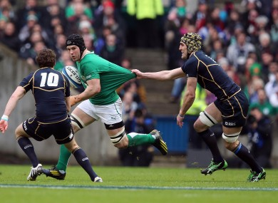 Kelly Brown (r) attempts to slow down O'Brien.