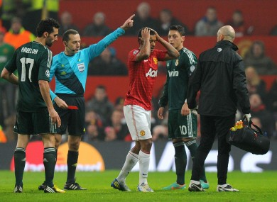 Manchester United's Nani is sent off after receiving a red card from referee Cuneyt Cakir.