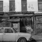 Though the name is unreadable, this was a functioning bar on the lower Falls Road, and like others had a little breeze-block bunker built over the front door to make sectarian attacks more difficult.