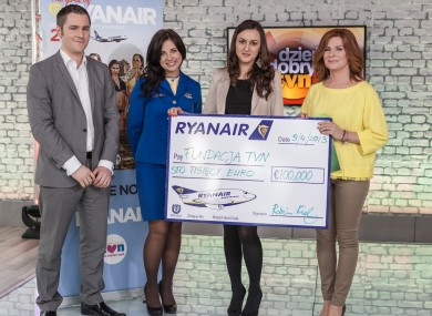 Ryanair's Robin Kiely, Kasia Gaborec and Patrycja Wagner presenting Anna Maruszeczko from the TVN Foundation with a €100,000 cheque, the sales proceeds of the Ryanair 2013 Cabin Crew Charity Calendar.