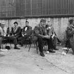 At the back of the Nonconformist Church bandsmen and others assembling for the '12th' Parade sit to enjoy their tea and sandwiches.